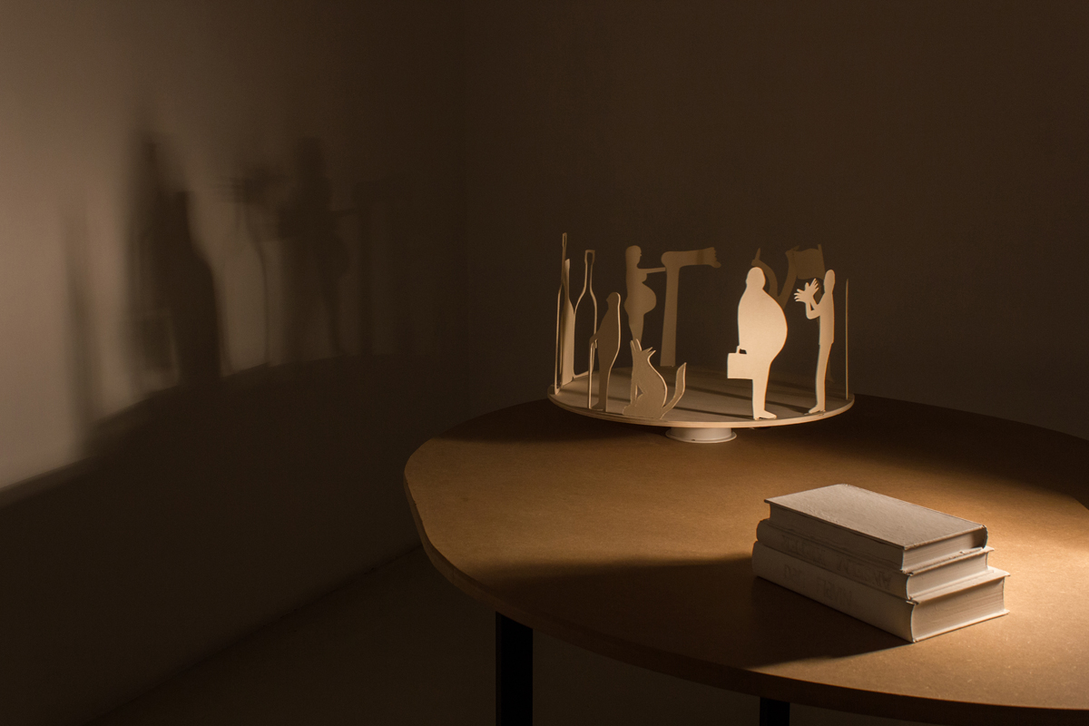 Ogni esercito ha bisogno di una bandiera, 2013 table, paper, wood, motorized rotating platform, halogen light, cm 121 x 158 x 80